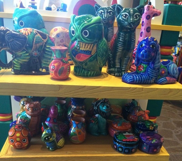 Here Are Some Bright Glass Figurines That Represent Disneys Caribbean Beach Resort Well Of These Pieces Double As Jewelry Boxes