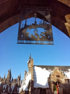 Signage above the archway as you enter Hogsmeade.