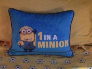 A Minion pillow sits on each bed