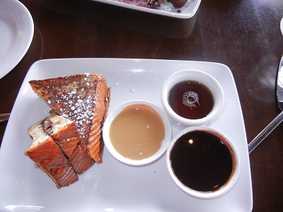 Chocolate milk-dipped haupia bread french toast with bananas and peanut butter