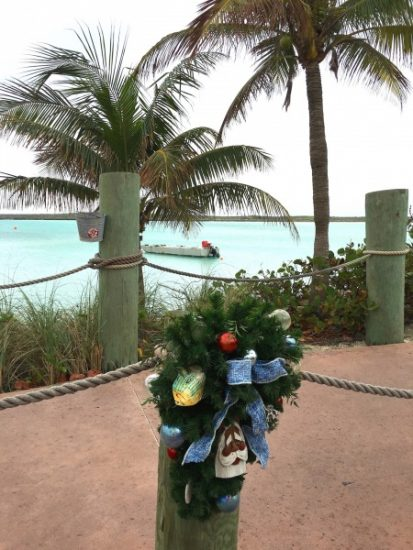 Castaway Cay, Disney's private island paradise, has holiday wreaths lining the path from the ship to the beach.