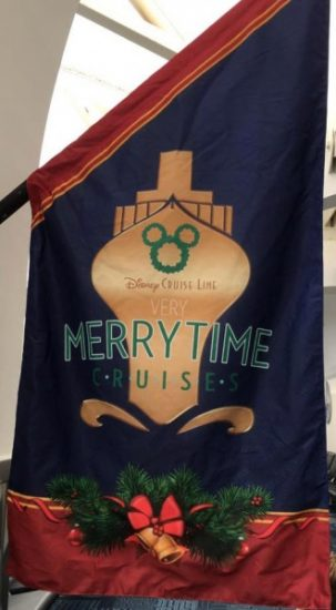 Decorative holiday flags line the walls and show you the way to check-in at the port terminal.