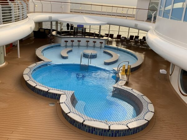 Enjoy a dip or a drink at the Quiet Cove Pool on the Disney Fantasy