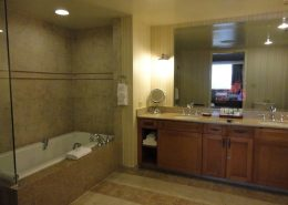 One Bedroom Suite Bathroom with TV in Mirror - Disney's Paradise Pier Hotel